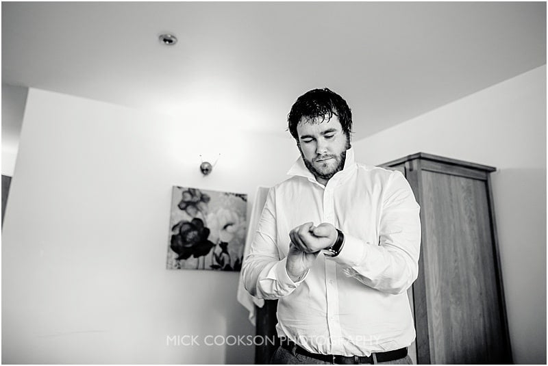 groom getting ready at charnock farm