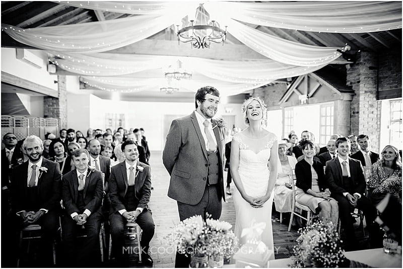 laughing bride and groom at charnock farm