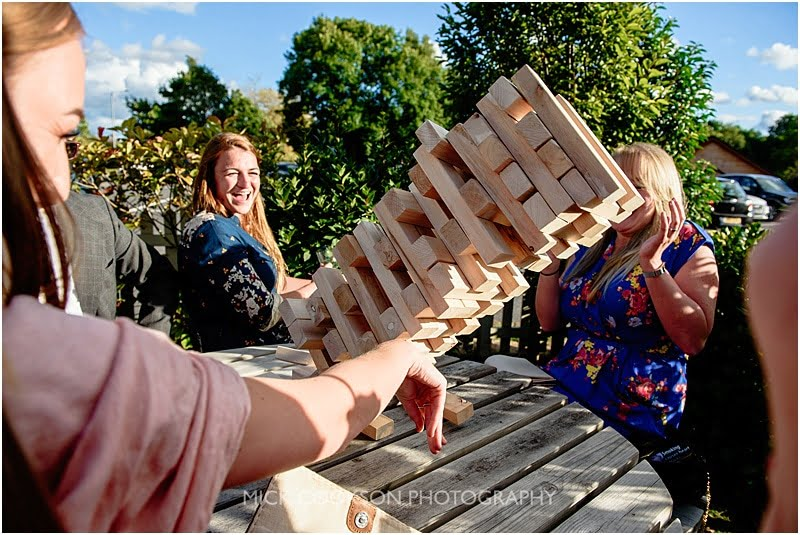 jenga tower collapsing at a charnock farm wedding