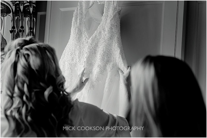 bridesmaids admiring a wedding dress at colshaw hall
