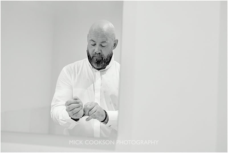 pensive groom getting ready at colshaw hall