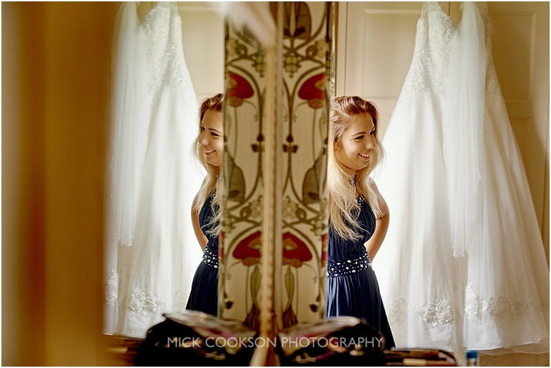 reflection of a bridesmaid in a mirror