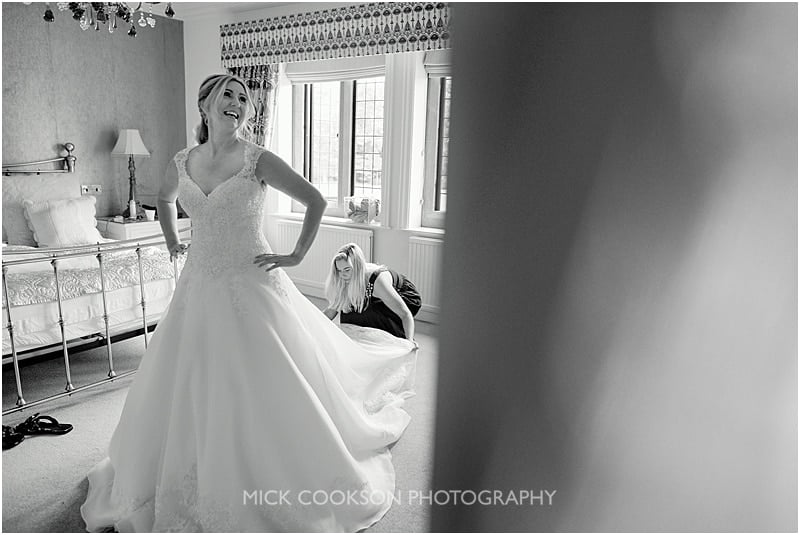 getting into the wedding dress at colshaw hall