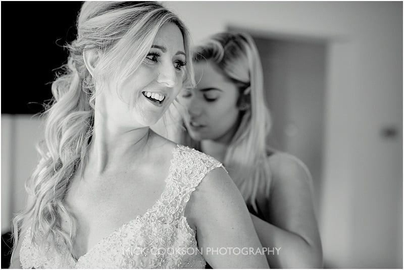 excited bride getting dressed at colshaw hall