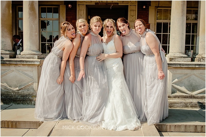bridesmaids having fun at eaves hall