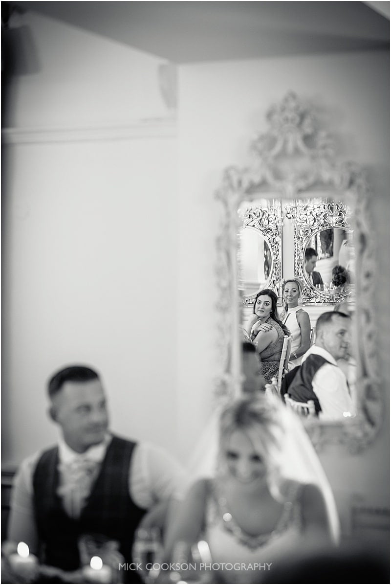 wedding guests reflected in a mirror