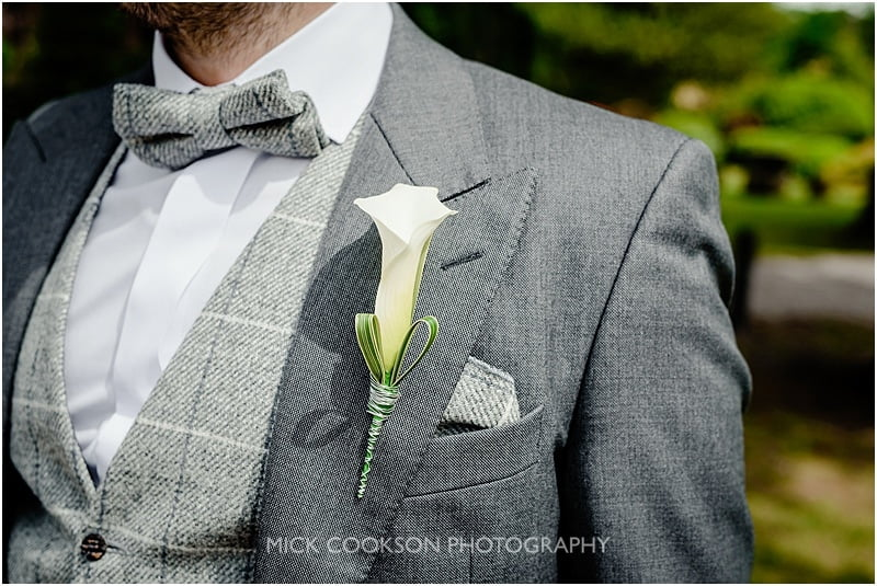 groom's button hole at a mitton hall wedding