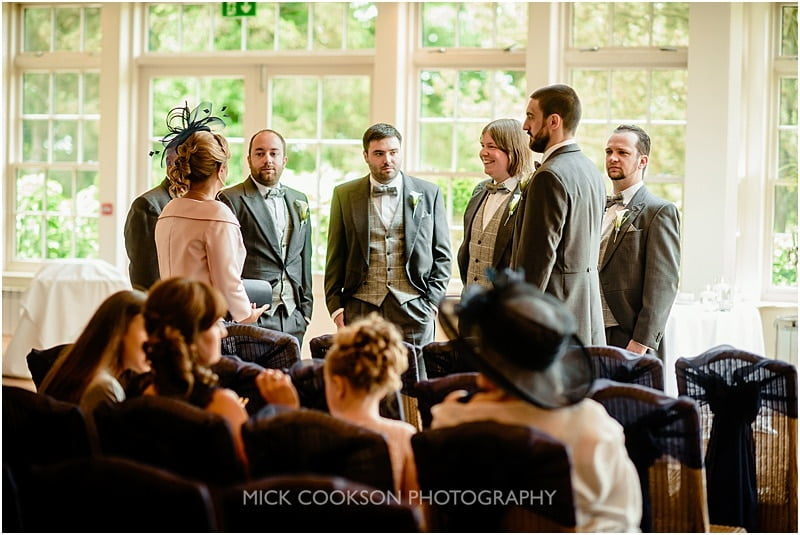 groomsmen gathered at a mitton hall wedding