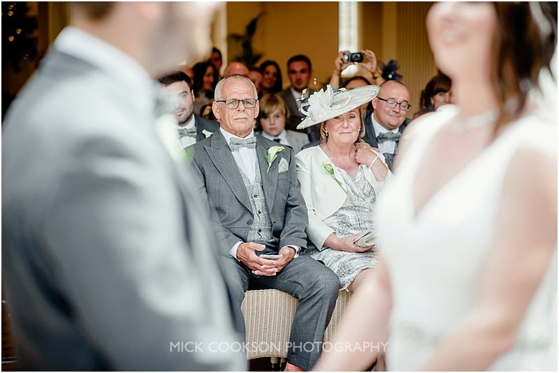 parents look on as their daughter gets married at mitton hall