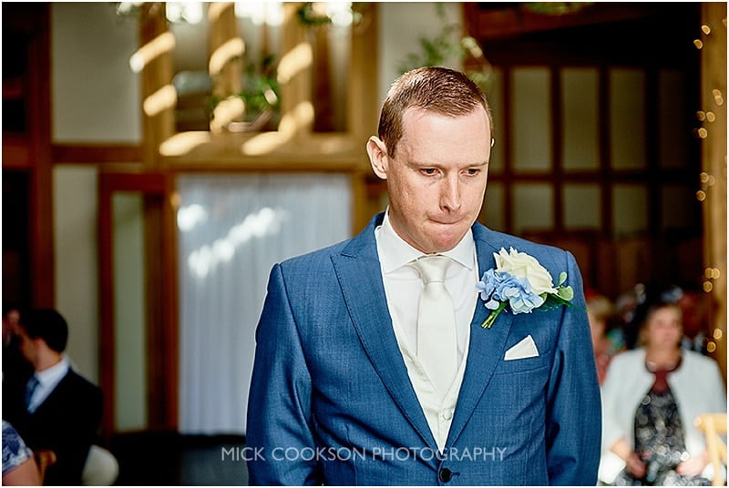 nervous groom at his oak tree of peover wedding