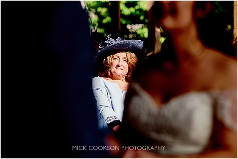 mother of the bride watches her daughter getting married