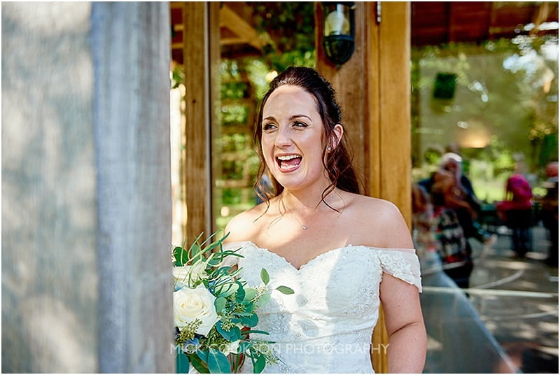 ecstatic bride at her oak tree of peover wedding