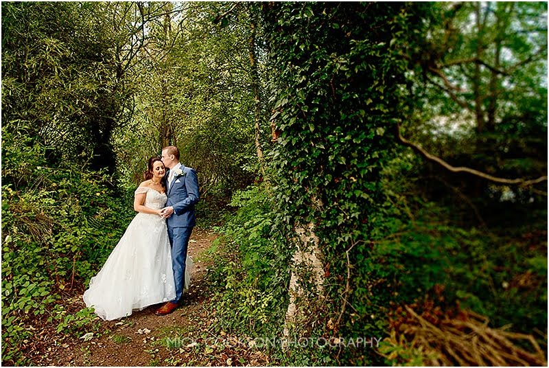 bride and groom at oak tree of peover wedding