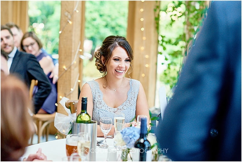 happy bridesmaid at an oak tree of peover wedding
