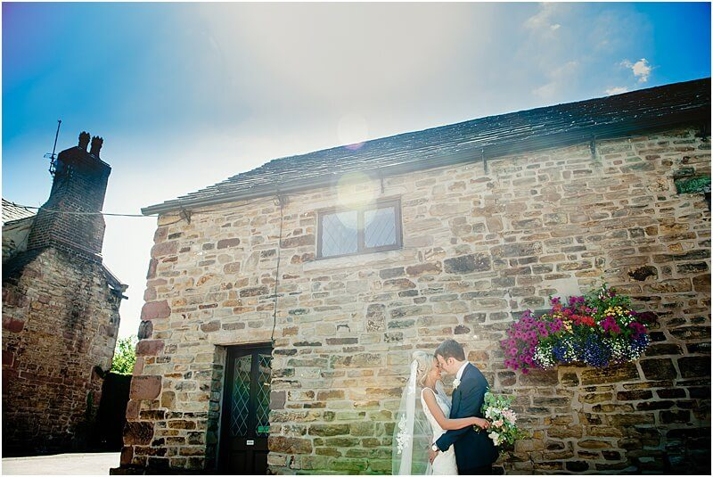 bride and groom wedding photo at hyde bank farm taken by manchester wedding photographer mick cookson
