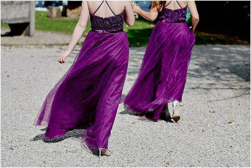 stunning cadburys purple bridesmaids dresses at mitton hall taken by manchester wedding photographer mick cookson