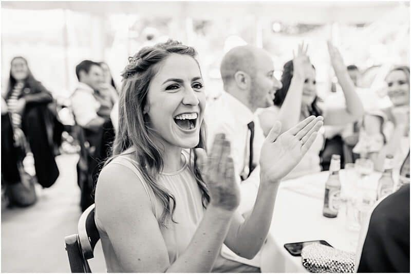 bridesmaid enjoying the speeches at bartle hall taken by manchester wedding photographer mick cookson