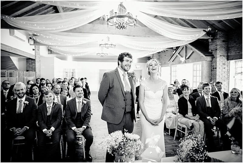 bride and groom wedding photo at charnock farm taken by manchester wedding photographer mick cookson