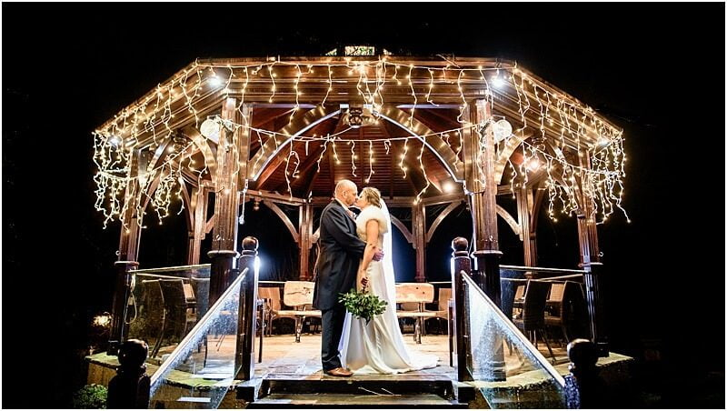 stunning winter wedding photo taken at gibbon bridge by manchester wedding photographer mick cookson