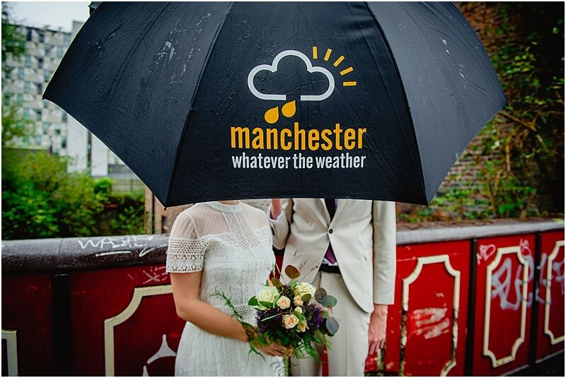 elopement wedding photo in the manchester rain taken by manchester wedding photographer mick cookson