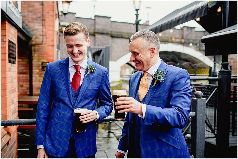 groom and his son and best man share a beer in sale taken by manchester wedding photographer mick cookson