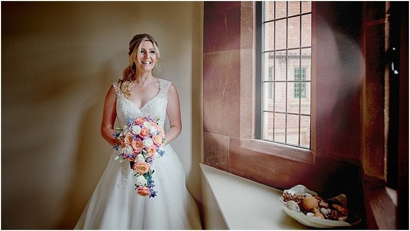 excited bride at a colshaw hall wedding taken by manchester wedding photographer mick cookson