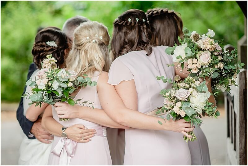 bridesmaids hugging outside church