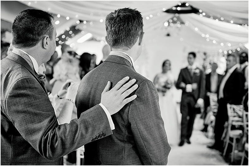best man comforts the groom