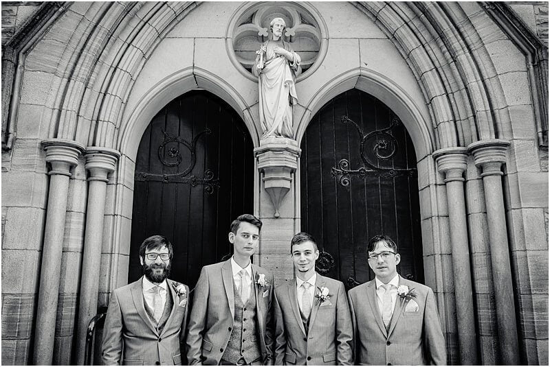 groomsmen standing outside church