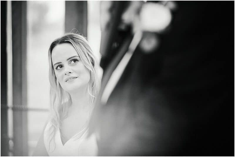 bride listening to her father's speech at a wedding at sandhole oak barn