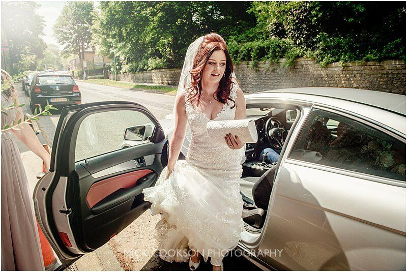 bride getting out of a mercedes