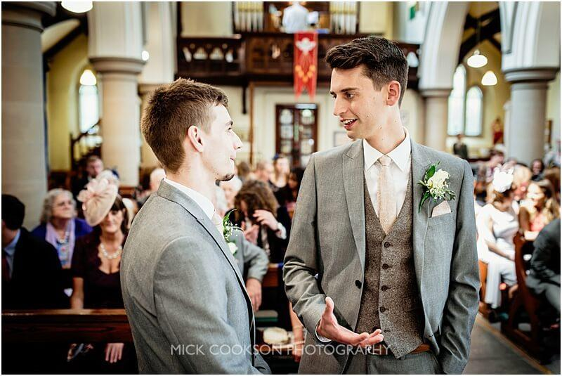 groom and best man chatting in church