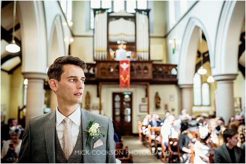 pensive groom in church