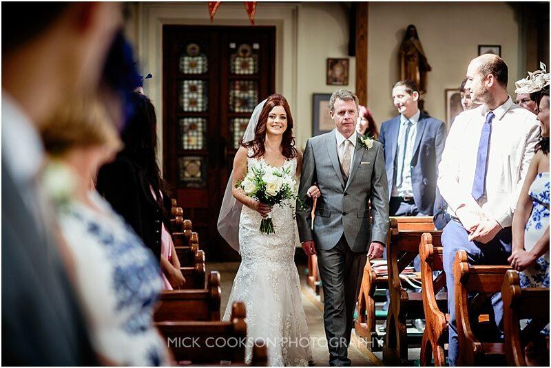 bride walks down the aisle at her fishermans retreat wedding