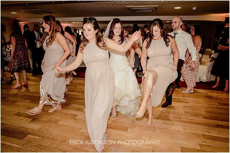 bridesmaids dancing the macarena at the fishermans retreat by mick cookson photography