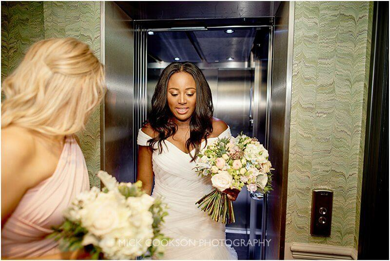 bride getting out of the lift at king street town house