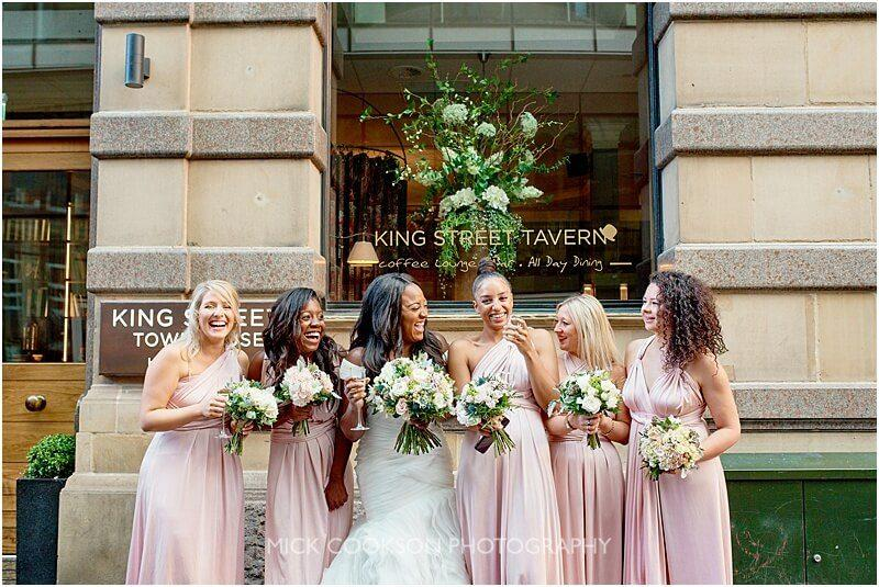 bridesmaids laughing outside king street town house