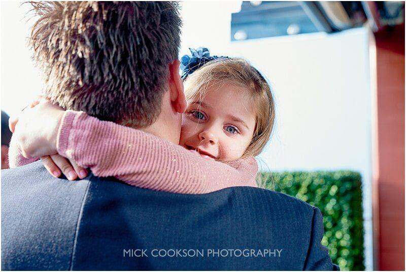 daughter hugs at a king street townhouse wedding