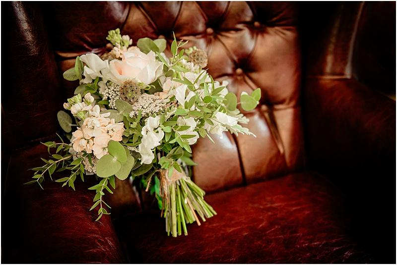 wedding bouquet on a leather chair