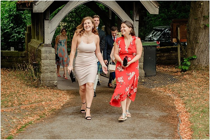 wedding guests arriving at edale church