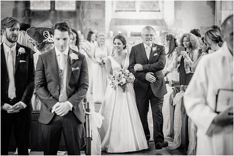 bride escorted by her father in edale church