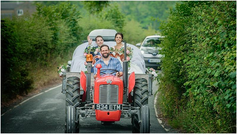 bride and groom arrive by tractor