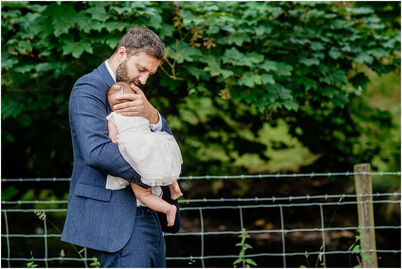 dad with baby daughter at a wedding