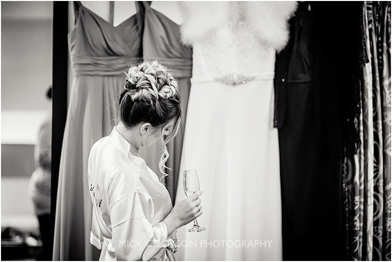 bridesmaid admiring the wedding dress at gibbon bridge wedding venue