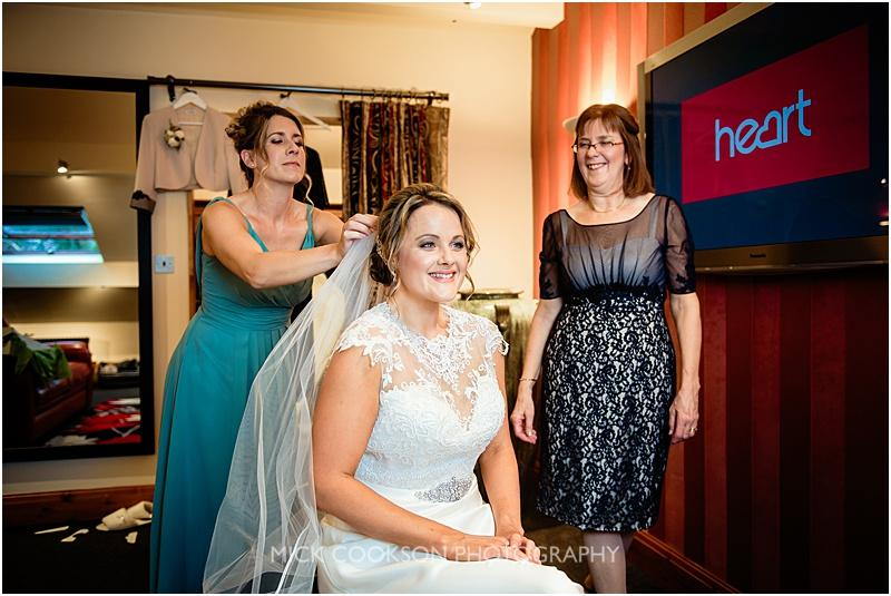 happy mother of the bride at gibbon bridge wedding venue