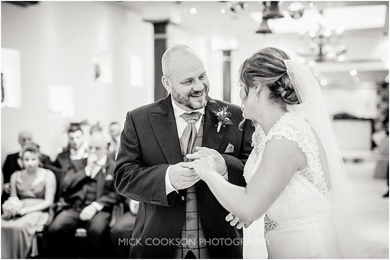 bride puts the ring on the groom at a gibbon bridge winter wedding