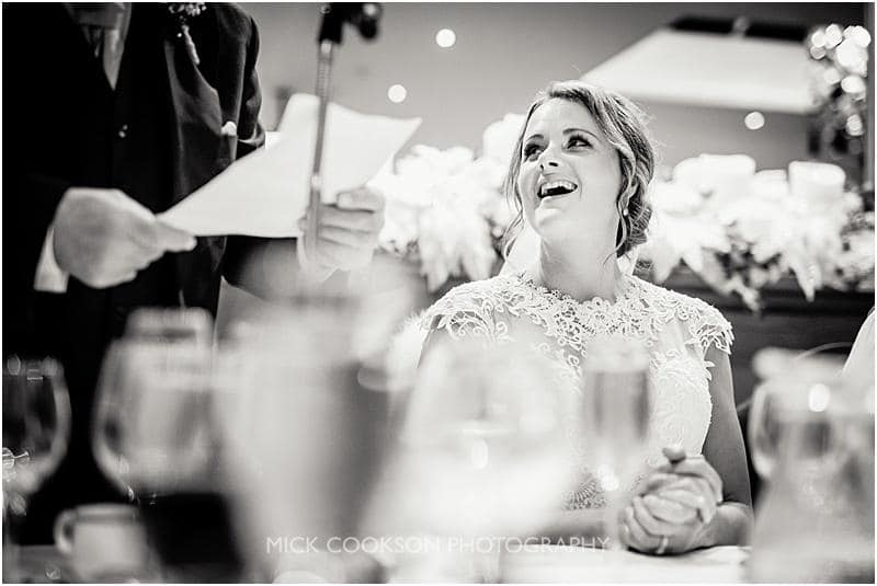 bride laughing at the speeches at a gibbon bridge winter wedding