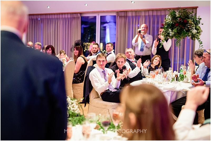 applause for the speeches at a gibbon bridge winter wedding