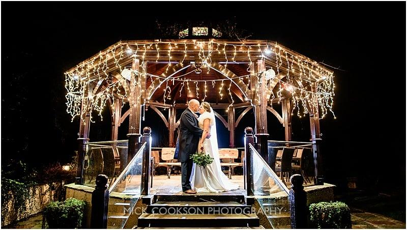 stunning wedding night photo at a gibbon bridge winter wedding