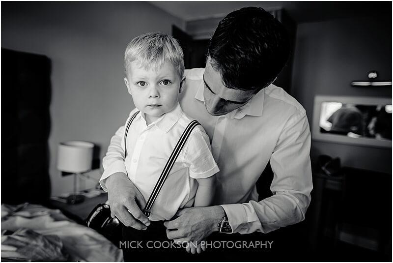 groom and his son getting ready at stirk house